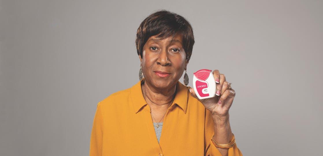 Woman holding ANORO ELLIPTA Inhaler