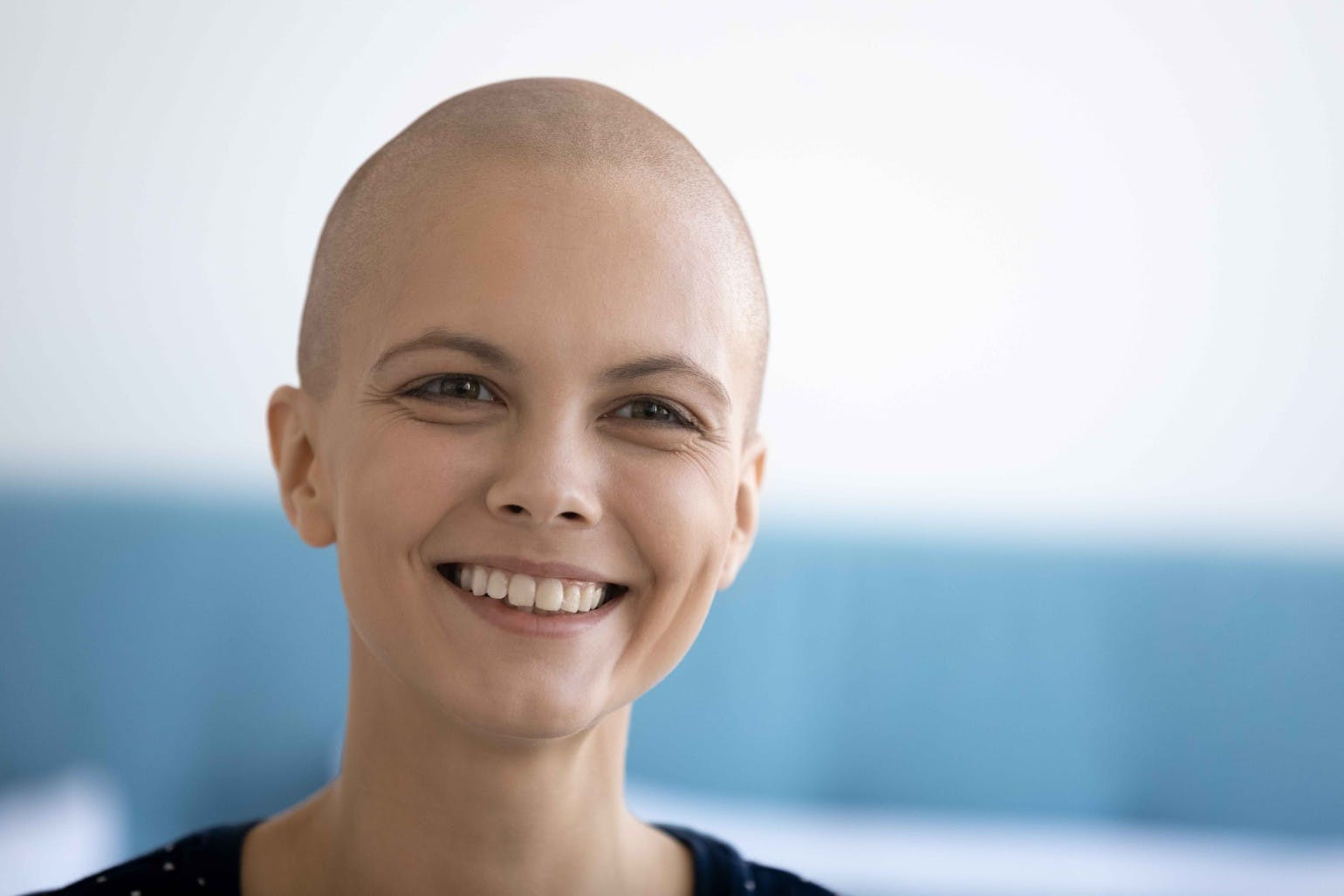 Happy young woman suffer from oncology look in distance dreaming