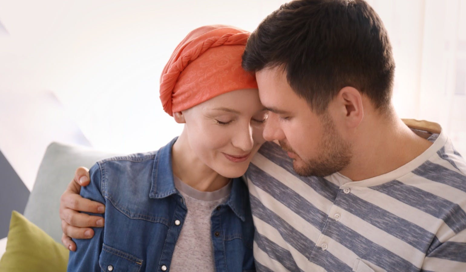 Husband visiting his wife with cancer indoors