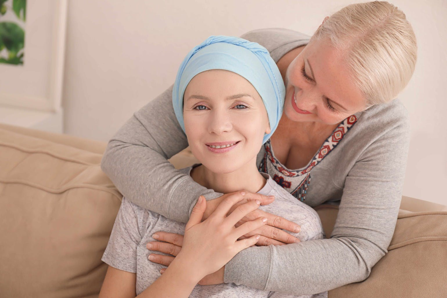 Mother visiting her daughter with cancer indoors