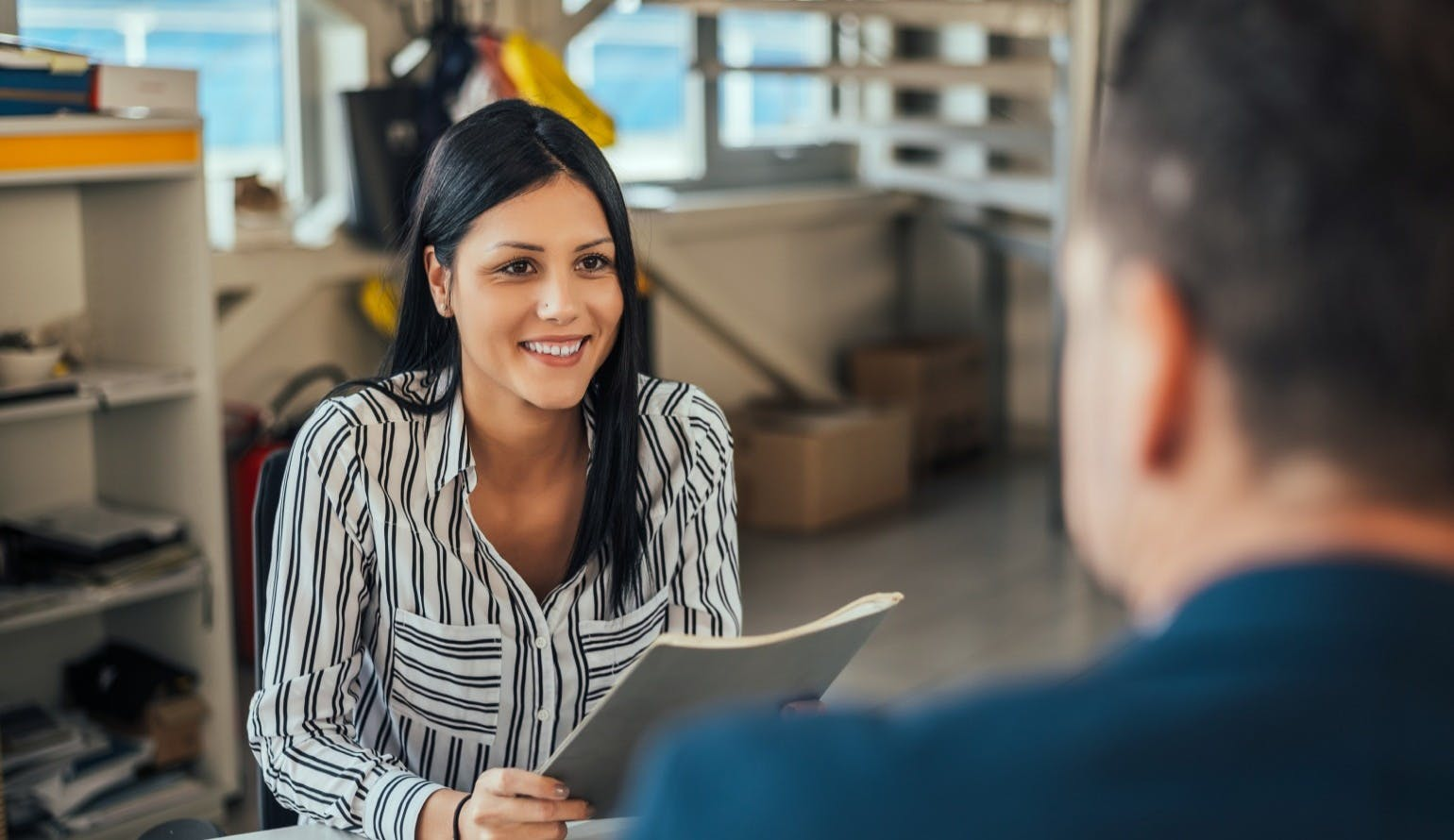Woman consultant talking with client in office