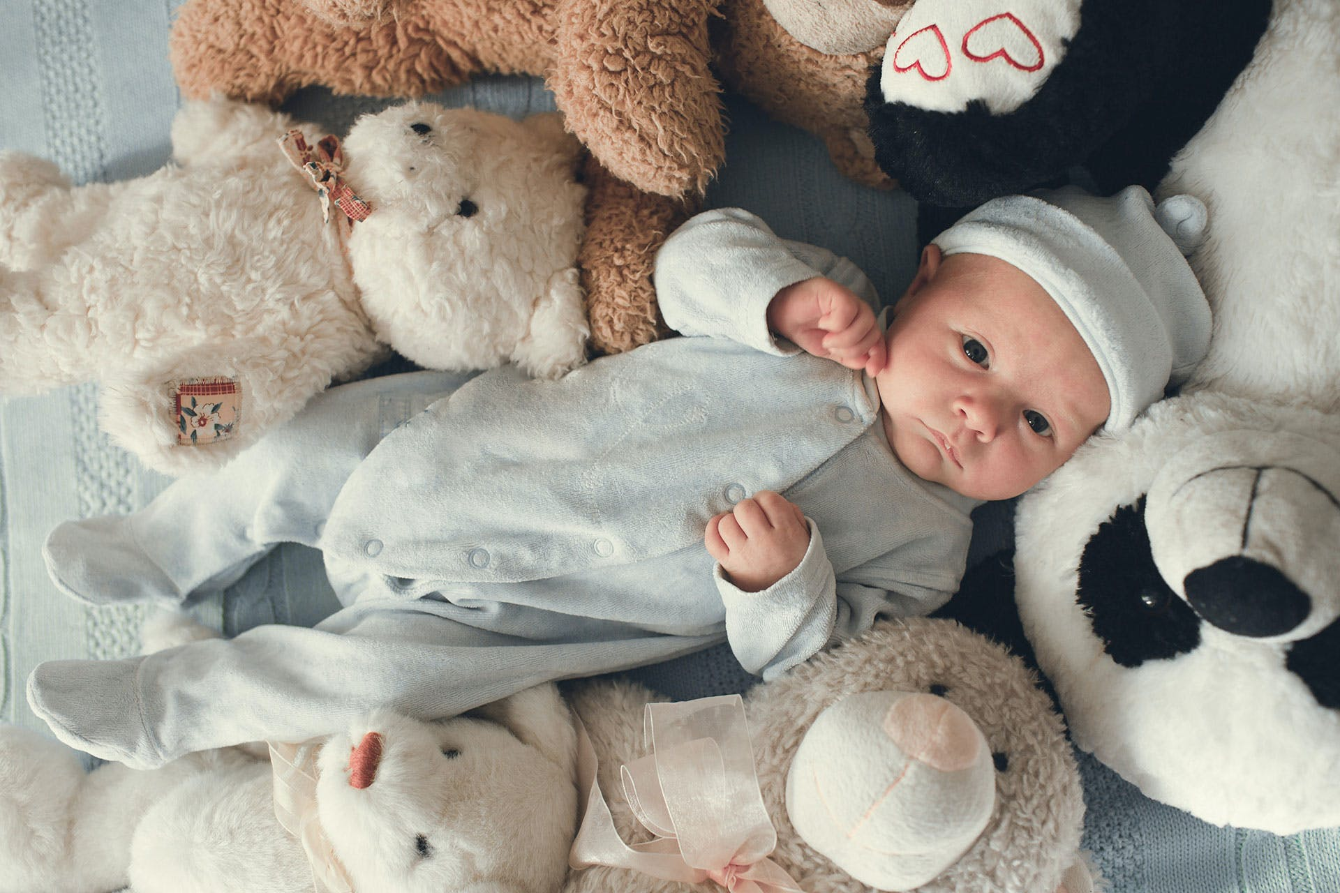 Image of baby with teddy bear
