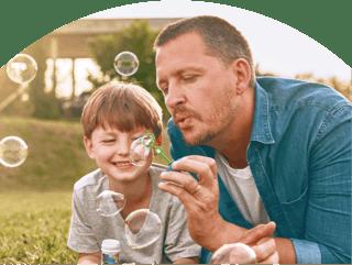 Image: Parent and Child Blowing Bubbles