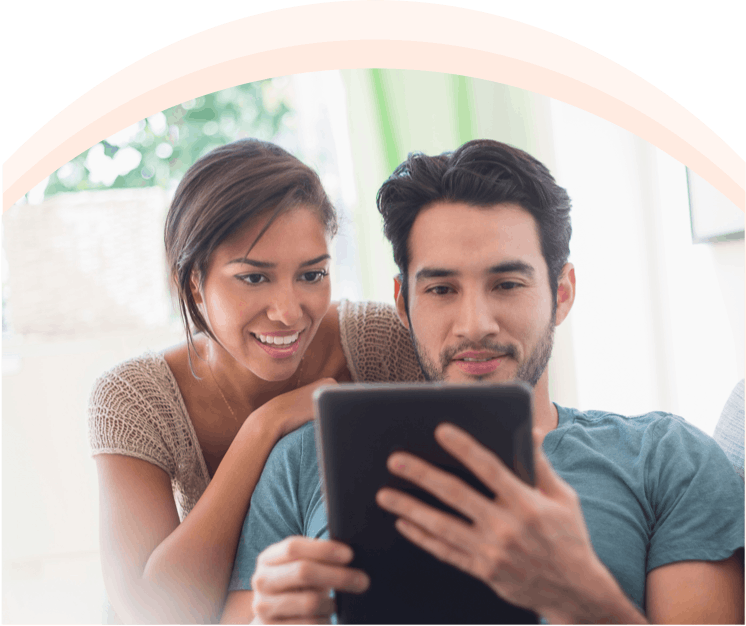 Image: Woman and Man Use Tablet