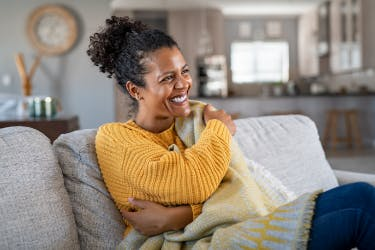 Woman-on-couch-smiling
