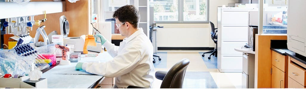 Researcher sitting at his lab desk working