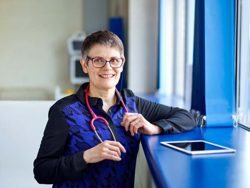 Smiley healthcare professional with stethoscope
